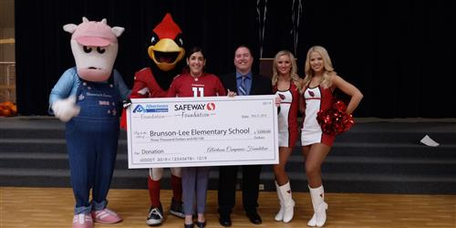 Shamrock mascot, Arizona Cardinals mascot & cheerleaders, & principals displaying check