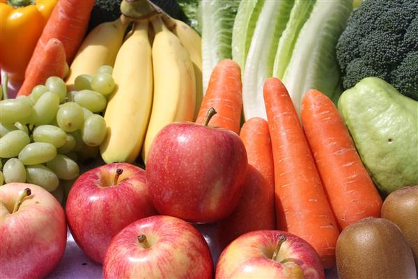 Image of assorted fruits and vegetables: bananas, carrots, lettuce, apples, grapes, bell peppers