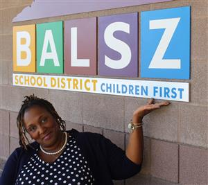 Dr. Arleen Kennedy under Balsz logo with hand under Children First