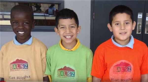 Three Balsz Students with t-shirts that say Eat Right!