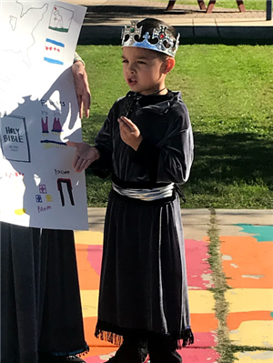 boy presenting about his culture