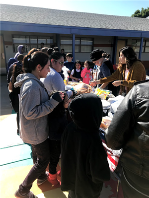 staff, students, and parents enjoying foods from different cultures