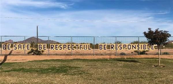 Fence decorated with be safe, be respectful, be responsible