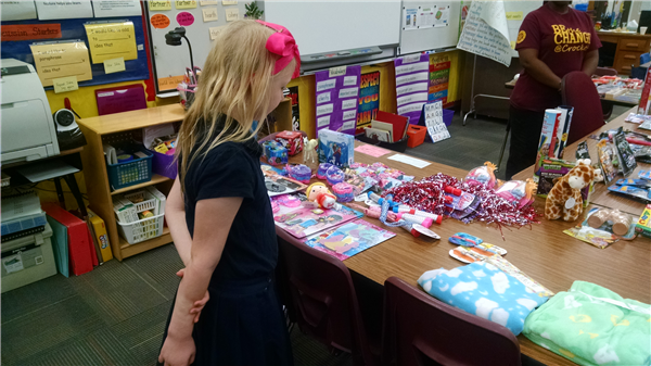 Student looking at donated gifts