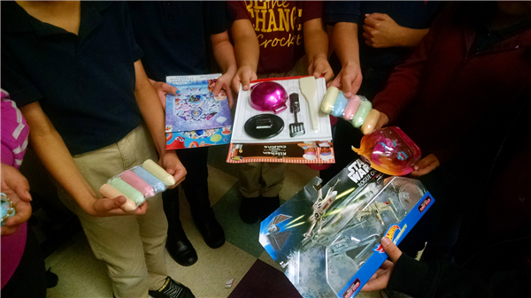 Students holding donated gifts