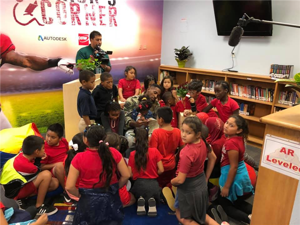Patrick Peterson reading to students