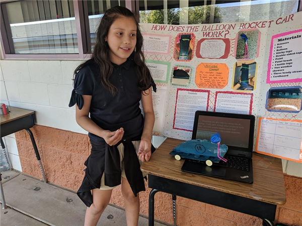 Student showing Balloon Rocket Car project