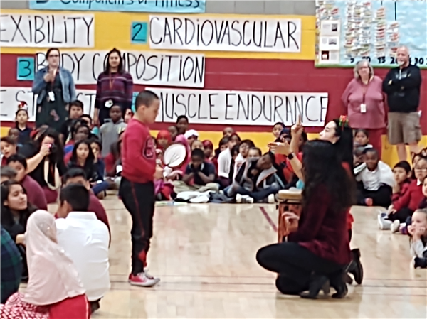 Students drumming at winter program