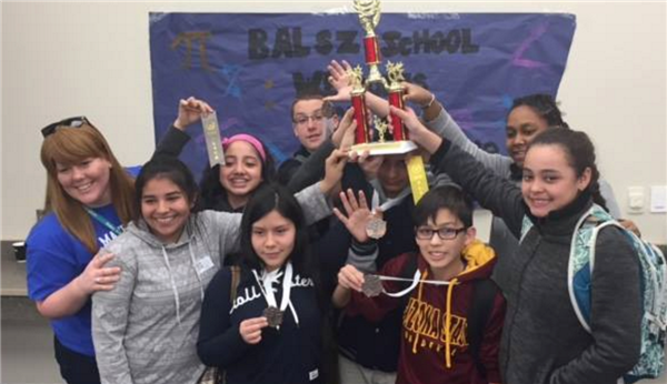 Junior High Students Displaying Math Trophy